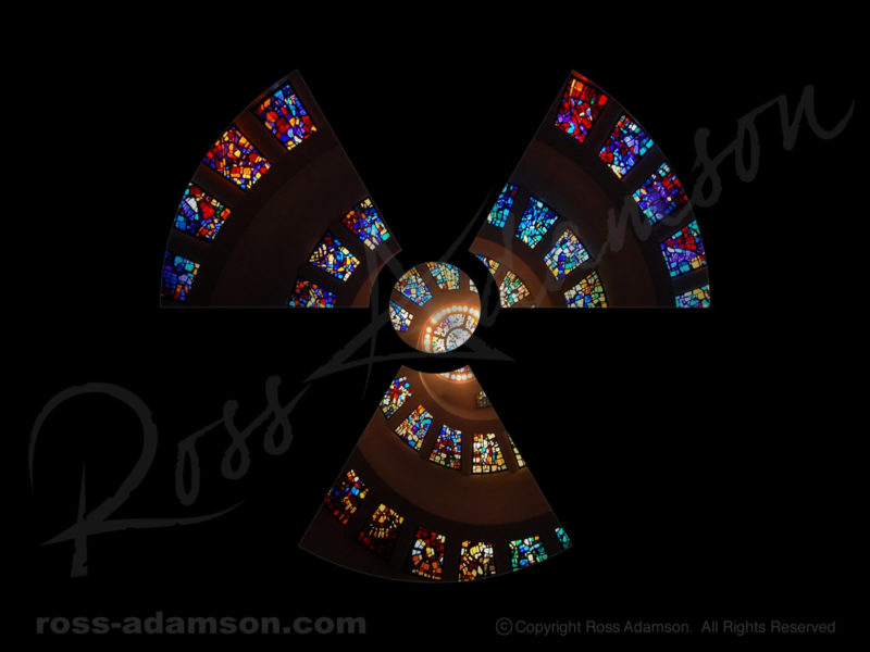 Vector graphic: Radioactive hazard symbol with photo of stained glass.
